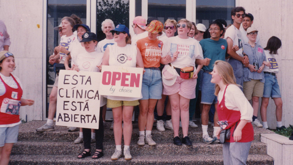 Image of women and men protesting outside of a building from the Carey Shuart Women's Research Collection
