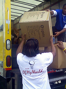 image of world vision volunteers unloading a truck
