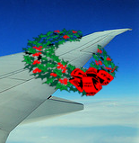 image of airplane wing with a holiday wreath