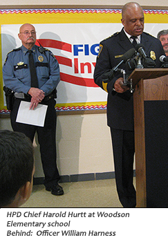 image of HPD Chief Harold Hurtt and Officer William Harness at press conference