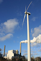 image of power station that uses multiple sources of energy, including wind and coal