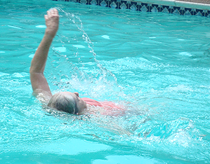 image of Knight swimming the backstroke