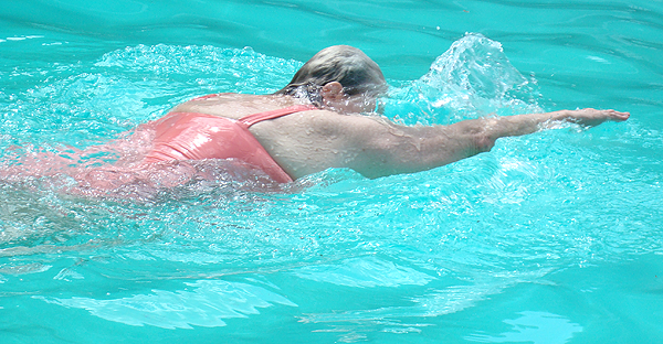 image of Knight swimming the breaststroke