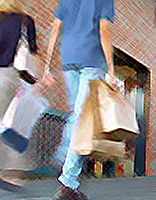 poeple walking with shopping bags