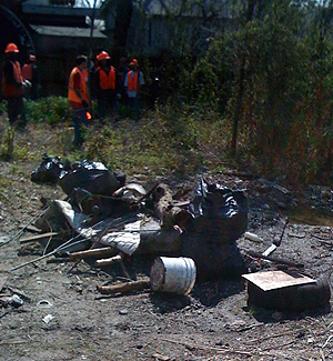 Dumping Trash Crew cleaning up lot