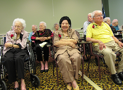 Carol Walker, Mary Tucker and Henry Prentice enjoy a party for centenarians in the Houston area.