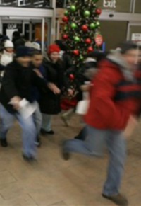 shoppers dashing into a store