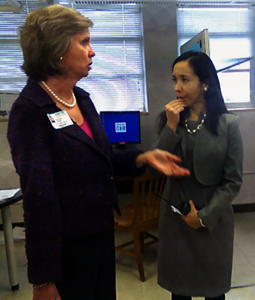 Lee High School principal Xochitl Davila listens to a Houston business leader