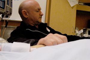 Mark E. Kelly at the side of wife Gabrielle Giffords in the University Medical Center, recovering from injuries sustained during Tucson shooting