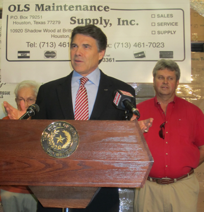 speaking Governor Perry and behind JoeOls