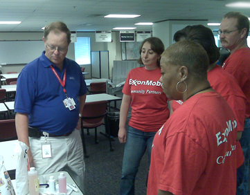 Red Cross volunteer supervisor Roy Clark instructs trainees