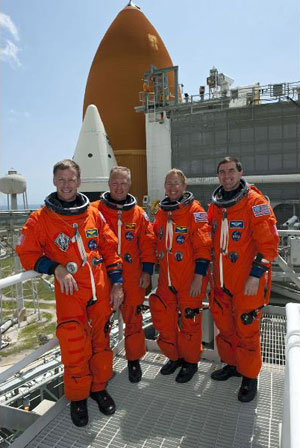 the STS-135 crew members pause for a photo in front of Atlantis
