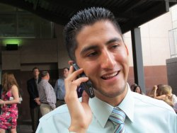 Irving Basanez chats on the phone during residency