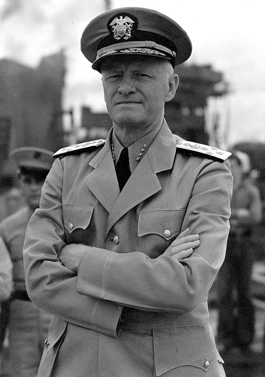 Admiral Chester W. Nimitz stands with arms cross across chest