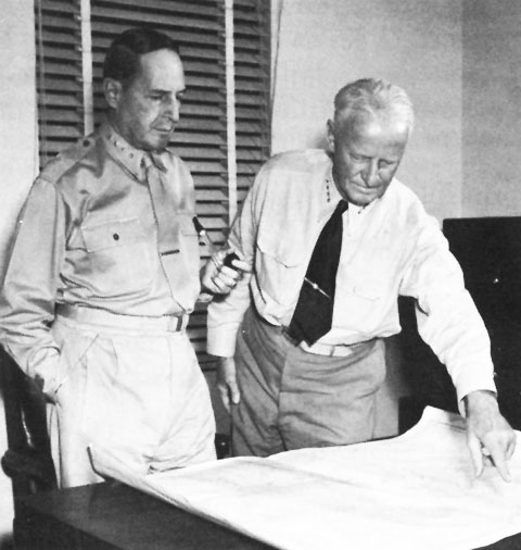 Admiral Chester Nimitz points at map