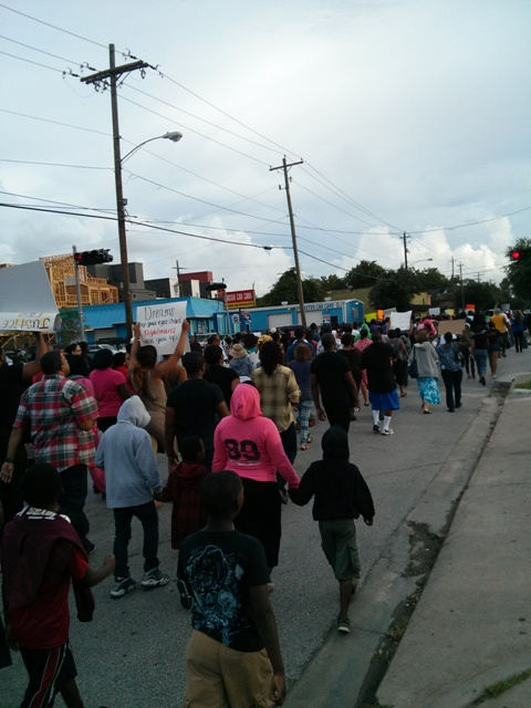 Houstonians marching along the streets in Third Ward toward the highway
