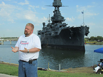 Mike Rufo stands in front of the Battleship Texas
