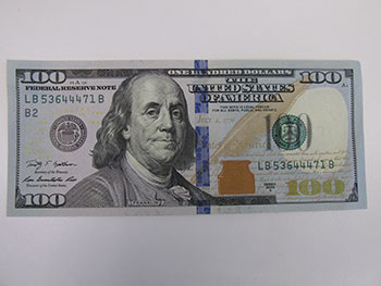 front of the new 100 dollar bill