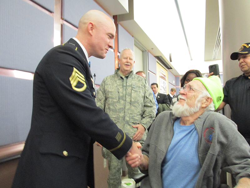 Ty Carter shaking a veterans hand