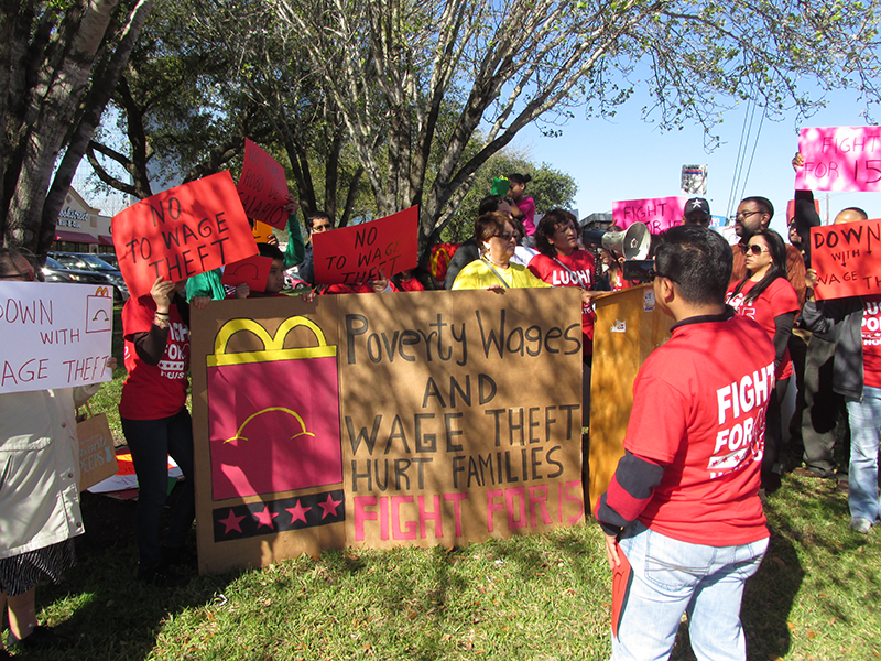 140318_McDonalds-protest-800px-red-signs.png