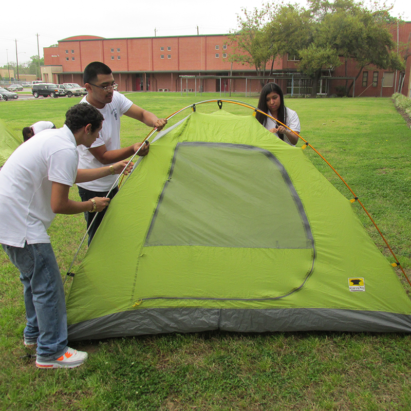Students at George Sanchez High School pitch a tent
