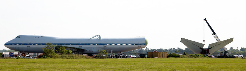 This Boeing 747 (SCA) was especially built to carry NASA's Shuttles. It's being taken apart on the far side of Ellington Field.