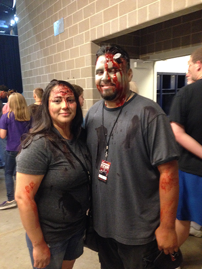 Two-participants-made-up-as-walkers-for-The-Walking-Dead-Escape-at-Reliant-Stadium.png