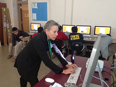 counselor Danette-Maldonado checking computer