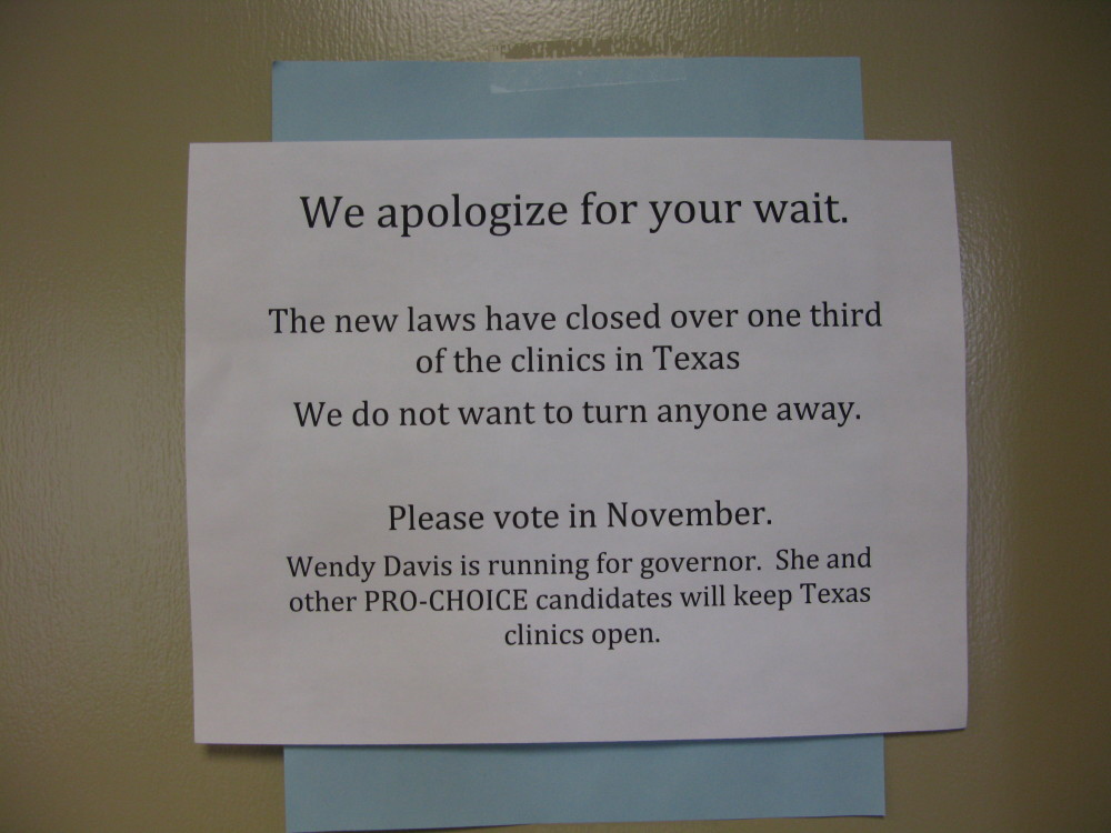 sign reads we apologize for your wait