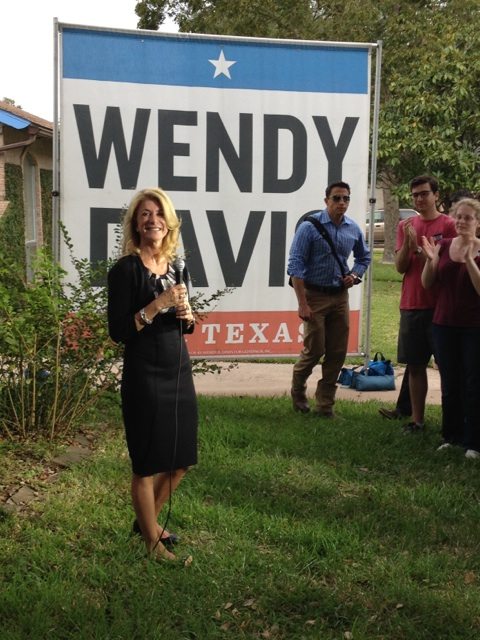 Wendy Davis stands in front of campaign sign