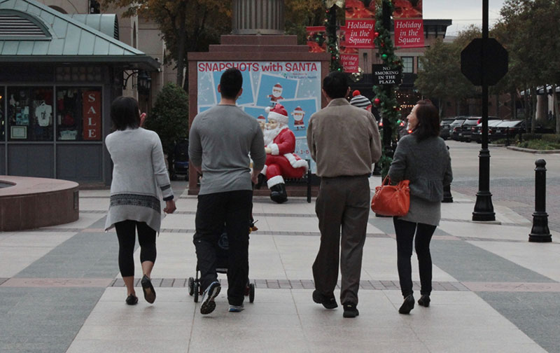 Ah-Lim-Tsai-with-his-wife_-Terry-Fan-_on-right_-walk-across-the-Sugar-Land-Town-Square