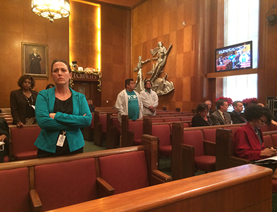 Community activists stand during City-Council