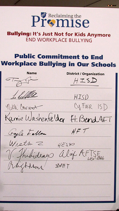 Local-school-leaders-signed-a-pledge-to-end-workplace-bullying-at-a-rally-Monday.jpg