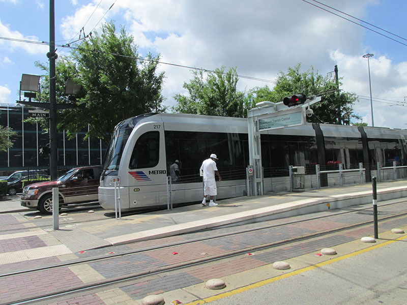 Metro-light-rail-train-makes-a-stop-at-the-Downtown-Transit-Center.jpg