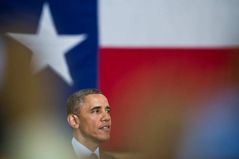 Obama in front of a Texas flag