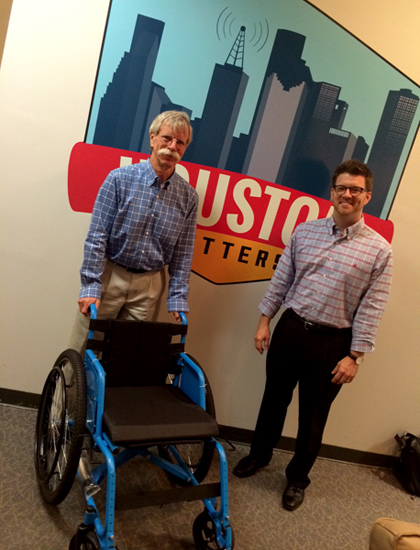Don Schoendorfer, founder of Free Wheelchair Mission, and Aaron Jean of the Houston chapter, pose with the organization's latest wheelchair design. (Photo: Michael Hagerty)