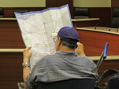 Rider looks over a map showing proposed changes