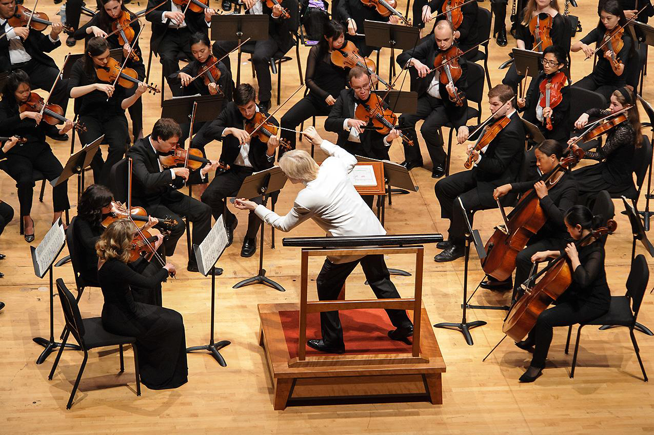 Maestro Franz Krager leads the Texas Music Festival Orchestra at their premiere concert in 2015
