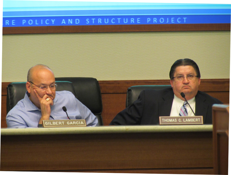 Metro Chairman Gilbert Garcia and CEO Tom Lambert listen to discussion at their July board meeting.