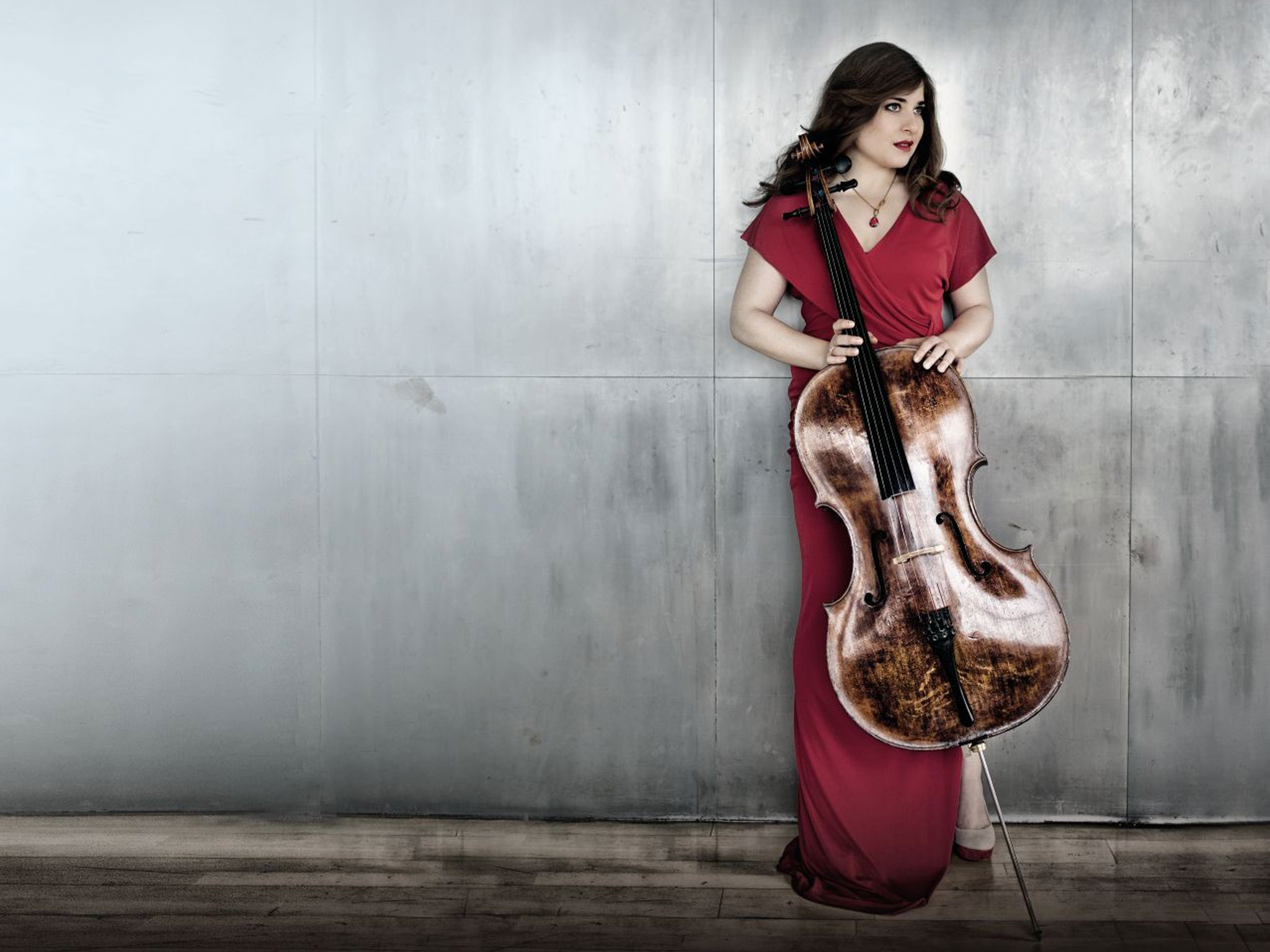 Cellist Alisa Weilerstein posing with cello