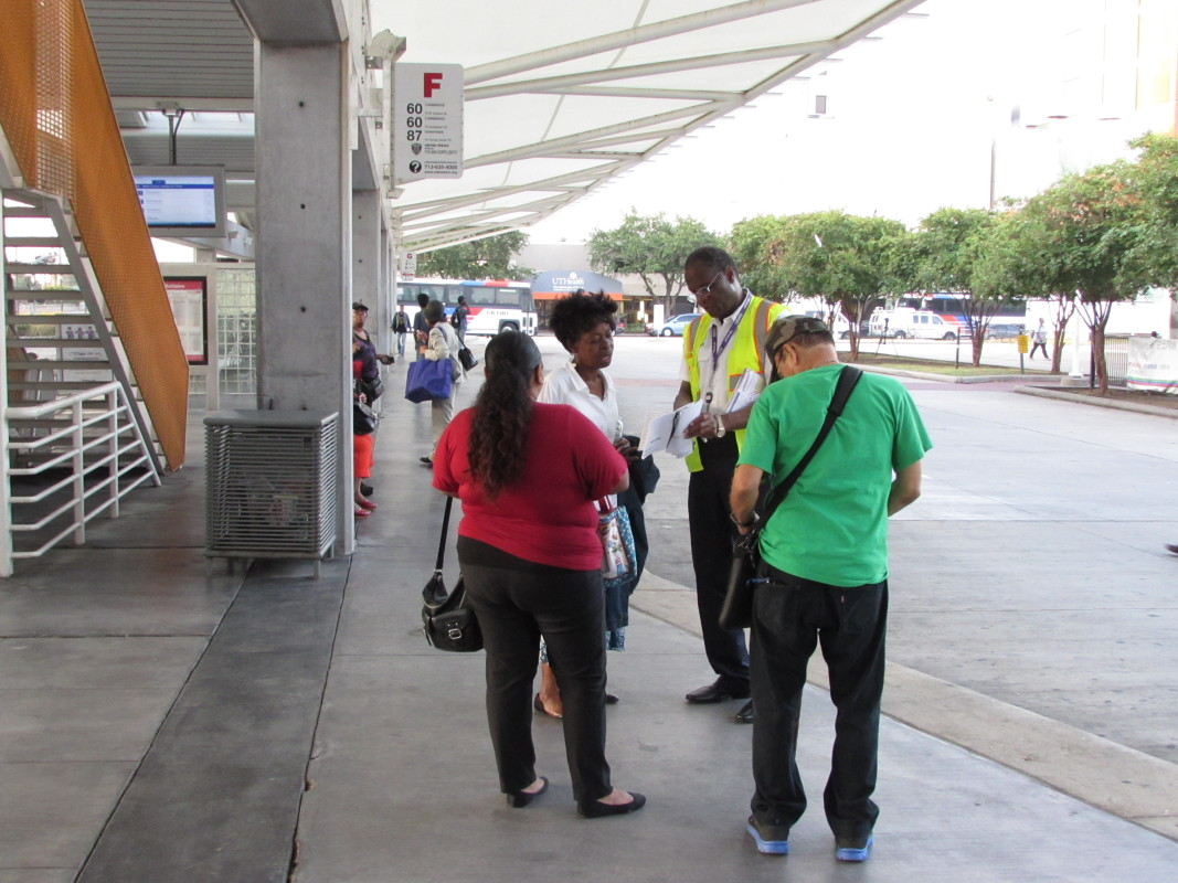 Photo of Metro employees help guide riders