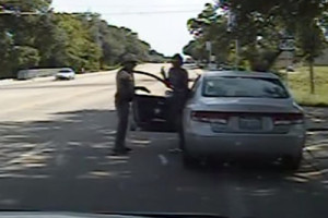 Screen grab of dashcam video shows Sandra Bland exiting her car during traffic stop
