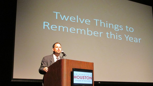 Superintendent John Kuhn gives advice and inspirational words from a podium at the University of Houston.