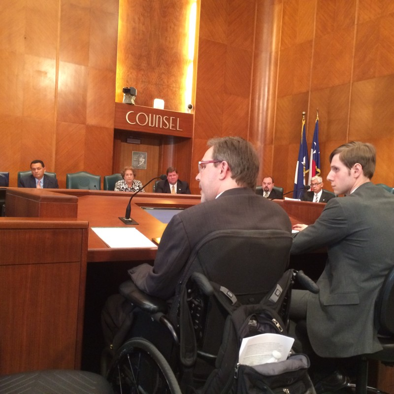Toby Cole (left) addresses a city council committee