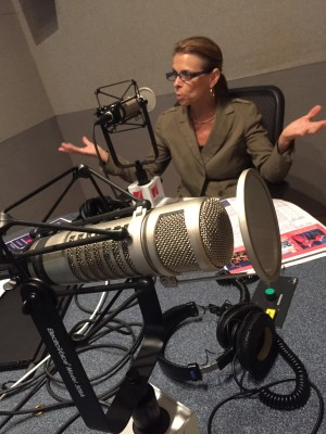 Theater District Houston CEO Kathryn McNiel being interviewed in the Houston Public Media radio studio