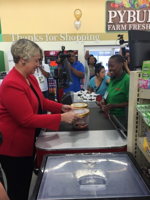 Houston Mayor Annise Parker purchases Blue Bell ice cream at a grocery store on Scott Street.