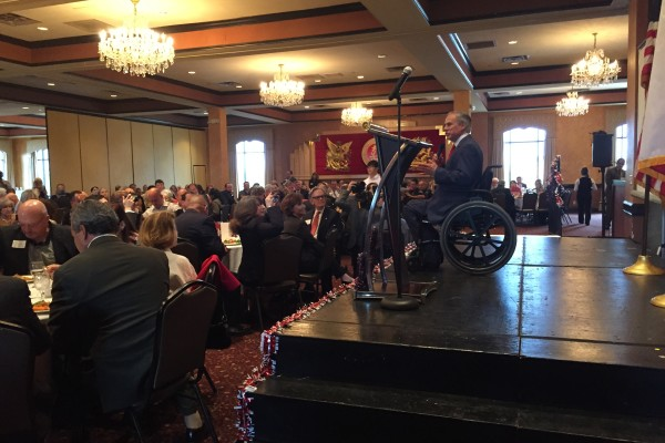 Texas Governor Greg Abbott is on stage addresses members of the Republican Party in Houston.