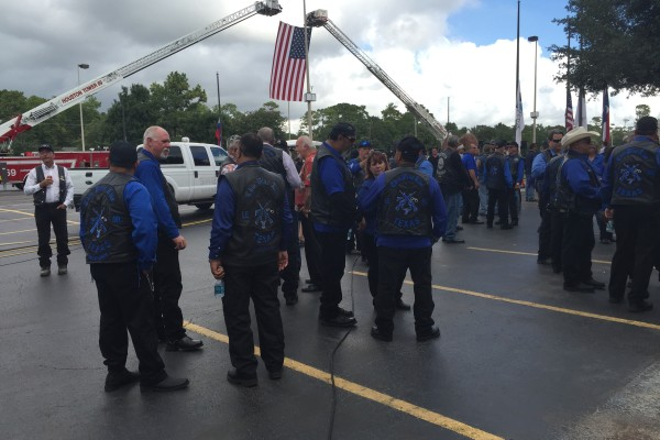Law enforcement officers gather outside a church for the funeral of Harris Conty Sheriff's Deputy Darren Goforth.