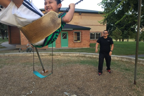 Fernando Aguilar plays with his son Isaac at Stude Park.
