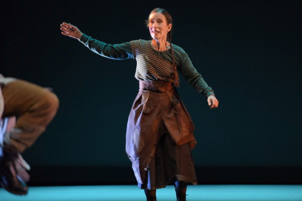 Photo of Meredith Monk performing on stage.